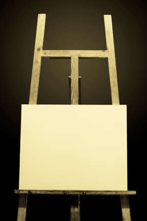 Cloth white wooden easel painting placing, under the deep blue background
