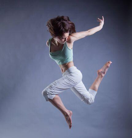 beauty girl dance on grey background
