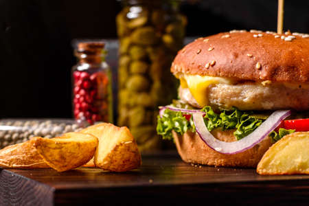 Photo pour Home made hamburger with lettuce and cheese. Close-up of home made tasty burgers on wooden table - image libre de droit