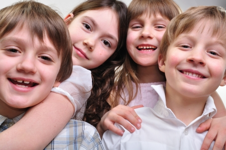 Photo pour group of happy smiling children friends hugging and playing together - image libre de droit