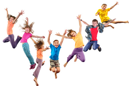 Foto de Large group of happy cheerful sportive children jumping and dancing. Isolated over white background. Childhood, freedom, happiness concept. - Imagen libre de derechos