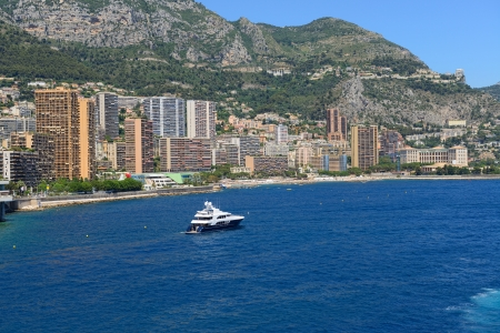 Monte Carlo cityscape and motorboat, Monaco