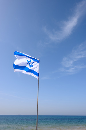 flag of Israel over blue sky and sea
