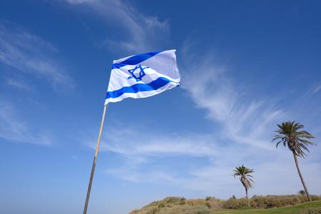flag of Israel over blue sky