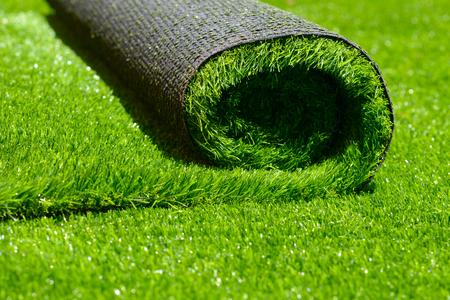 Foto de artificial rolled green grass; closeup - Imagen libre de derechos