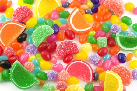 An assortment of colorful candy on full frame background with jellybeans, gumdrops and other jelly candies