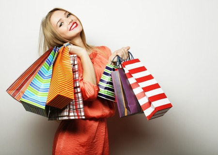 Photo for Portrait of young happy smiling woman with shopping bags, over white background - Royalty Free Image