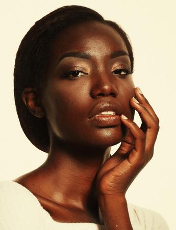 Photo pour Portrait of Young African model with a beautiful makeup in studio - image libre de droit
