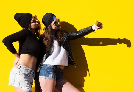 Photo for teenage girls friends outdoors make selfie on a phone. - Royalty Free Image