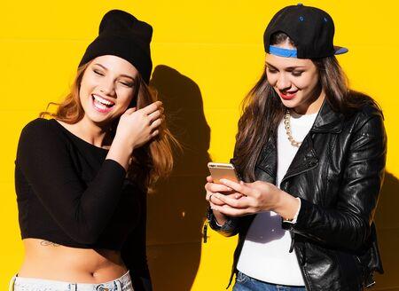 Photo pour teenage girls friends outdoors make selfie on a phone. - image libre de droit