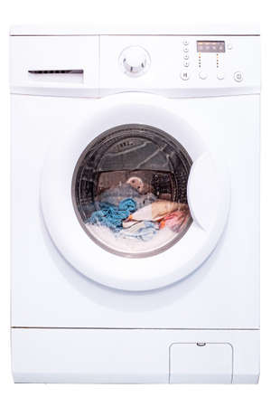 Photo pour Laundry in a washing machine. Automatic washing machine. Isolate on a white background. Front view - image libre de droit