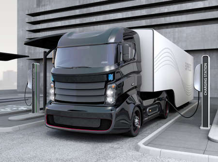 Photo pour Hybrid electric truck being charging at charging station - image libre de droit