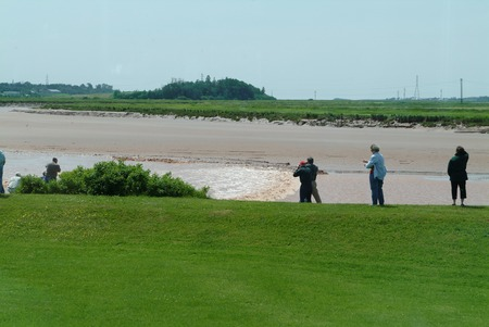 Tidal Bore rushing in as people gather to watch , Novia Scotia, Canada
