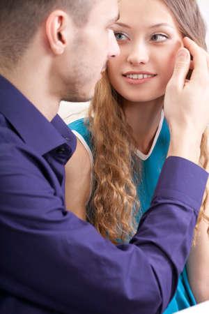closeup loving beautiful couple photo, guy touching hair of her girlfriend