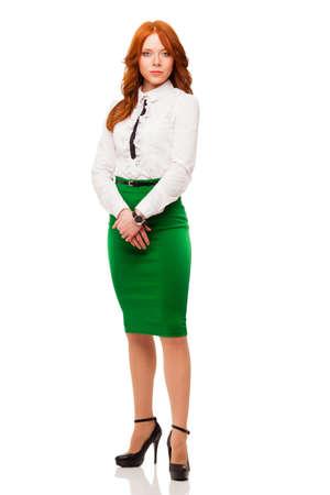 businesswoman wearing green skirt , full length isolated over white
