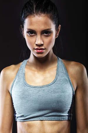 closeup portrait of sporty beautiful brunette woman