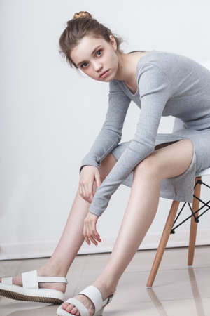 young teenage girl model sitting on the chair