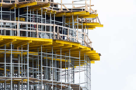 Photo pour View of scaffolding and structural reinforcement during the construction of a round building - image libre de droit