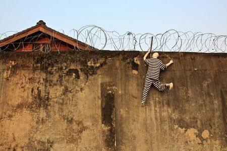 An Abstract escape on the prison Wall with Barbed wire