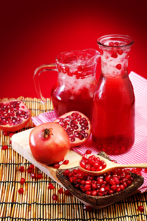 Pomegranate juice with red background