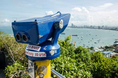 A coin-operated binocular viewer overlooking a vast vista