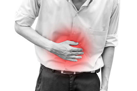 Man suffering from stomach ache because he has diarrhea
