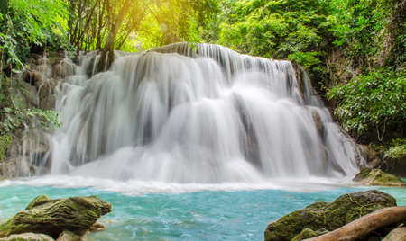 Photo pour Travel to the beautiful waterfall in tropical rain forest, soft water of the stream in the natural park at Huai Mae Khamin Waterfall in Kanchanaburi, Thailand. - image libre de droit