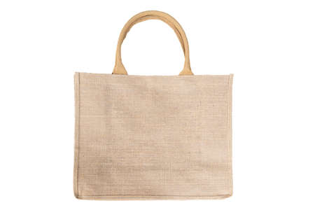Photo pour Shopping bag made out of recycled Hessian sack In Natural Brown Color Handles Isolated On White Background - image libre de droit