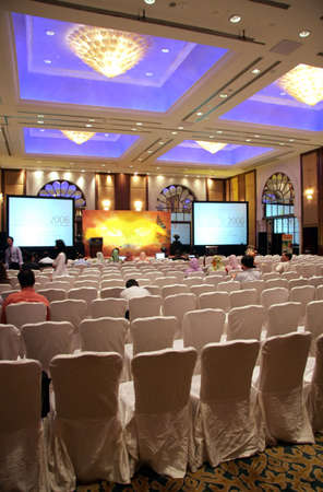 An empty-ish hall at a large launching ceremony held in a hotel