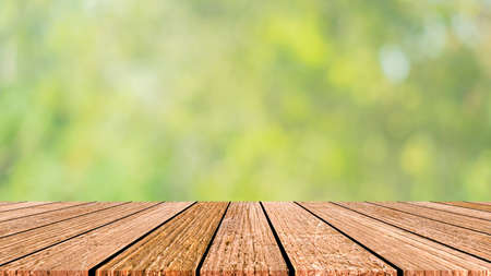Photo pour blur nature panoramic background with glow sunny light and aged plain wood table top perspective view for promote product concept. - image libre de droit