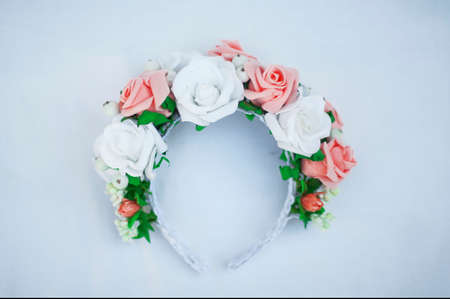 Hoop from flowers, wreath with colored flowers. Handmade flowers wreath on white. Accessory. Artificial flowers. Hair accessories. Beauty. Fashion. Decoration for the head. Wreath hair.