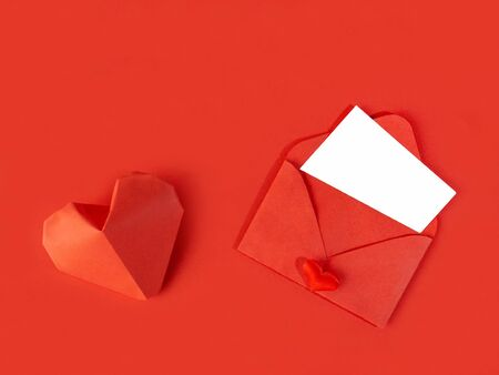 Photo for Red paper envelope with a note for Valentines Day on a white background with hearts - Royalty Free Image