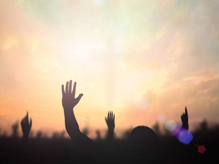 Photo for Belief, praise and worship concept: Silhouette christian people hand rising over blurred cross on spiritual light background - Royalty Free Image