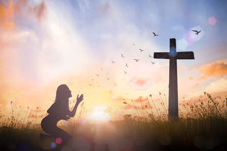 Photo for Silhouette woman hand rising for worship God over cross on sunset background - Royalty Free Image