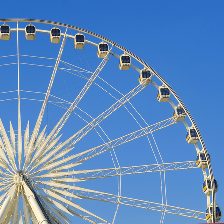 Beautiful large Ferris wheel. And the blue sky.