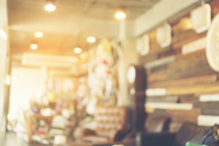 blurry background of coffee cafe with vintage light tone