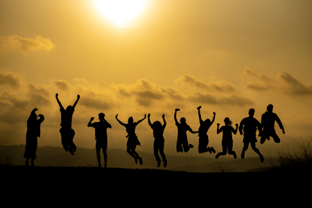 Photo pour Silhouette of happy business human team making high hands over head in sunset sky evening time background for business teamwork concept and freedom - image libre de droit