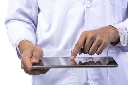 Photo pour Dentist using tablet smart phone for his work - image libre de droit