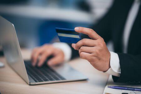 Foto de businessman working with credit card and laptop - Imagen libre de derechos