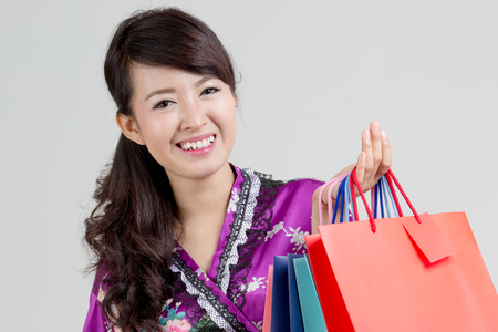 Asian shopping woman holding colorful shopping bagsの写真素材