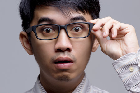 Close up of Asian businessman surprised face