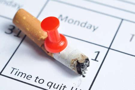 Cigarette impaled on calendar