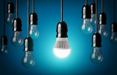 Photo for LED bulb and simple light bulbs Blue background  - Royalty Free Image