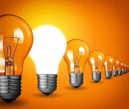 Photo pour Idea concept with light bulbs on orange background - image libre de droit