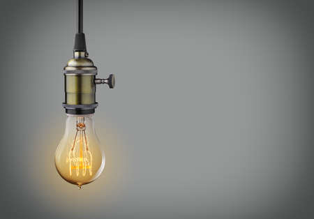 Photo for Vintage hanging light bulb over gray background - Royalty Free Image