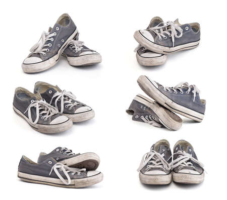 Photo pour Set of old dirty sneakers isolated on white background - image libre de droit