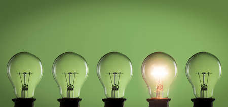 Photo for Idea concept. Light bulbs on green background - Royalty Free Image