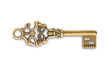 Foto de Vintage golden skeleton key isolated on white background - Imagen libre de derechos