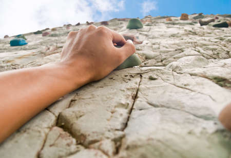 Photo for One hand to climb the cliff  - Royalty Free Image