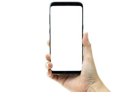 Photo for Woman hand holding black mobile phone with white screen at the background, smartphone blank screen - Royalty Free Image
